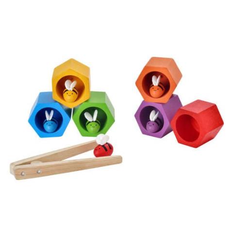 Nids d'abeille, jeu de motricité fine en bois coloré de Plantoys